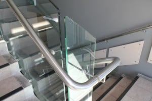 Through glass handrail brackets on internal stair