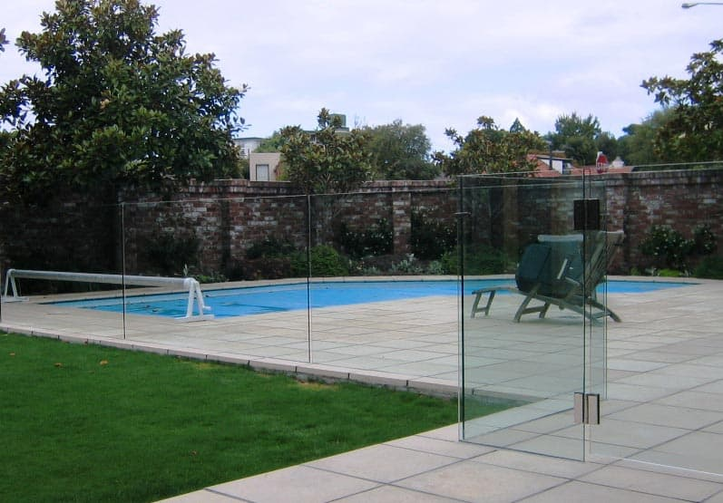 Frameless glass pool fences canterbury balustrades for Designer glass pool fencing